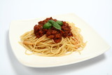 Pasta with bolognese sauce on a plate  with fresh basil