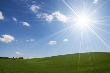 Bright sun over hills