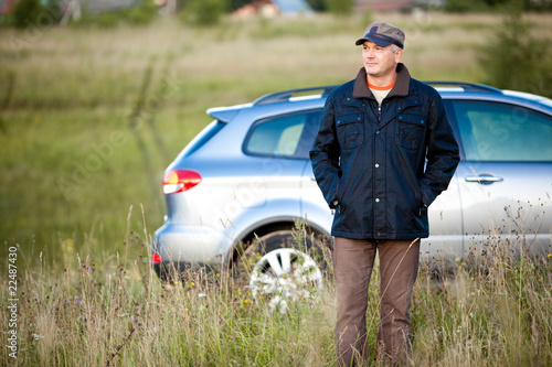adult man and car as the background