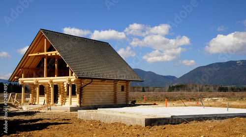 Leinwandbild Motiv Holzhäuser während der Bauphase