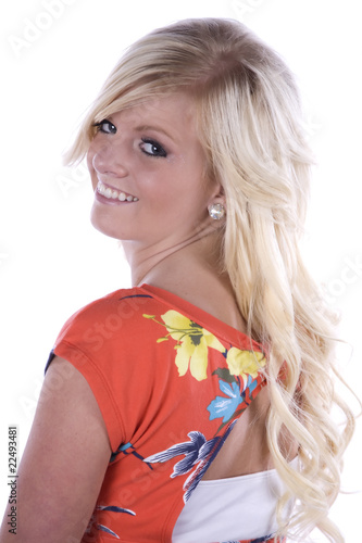 Girl flower shirt looking over shoulder