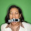 Businesswoman biting cellphone.