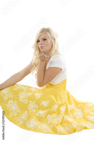 Girl in yellow dress blowing kiss