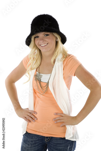 Girl with orange shirt and black hat