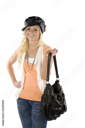 Woman in orange shirt holding purse