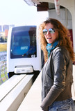 woman on a monorail station poster