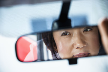 Woman in rearview mirror
