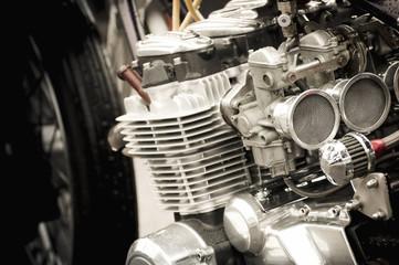 motorcycle carburetor and engine parts closeup