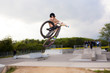 young boy going airborne with the bike