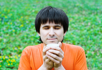 Man drinking coffee on nature