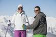 Young couple of skiers smiling at camera