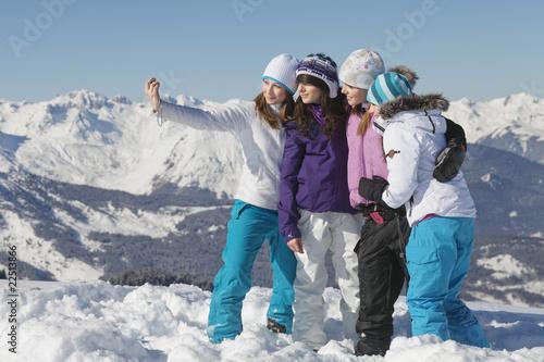 Fashion  Women on Four Teenage Girls In Ski Clothes  Taking Self Portrait    Onoky