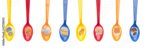 Variety of Cereals in Vibrant Spoons with Milk