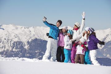 Family taking self portrait in snow