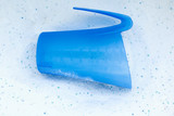 Close-up detergent with cup for laundry washing machine poster