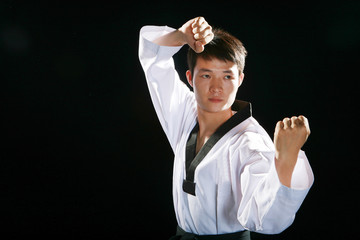 one asian man is playing with taekwondo