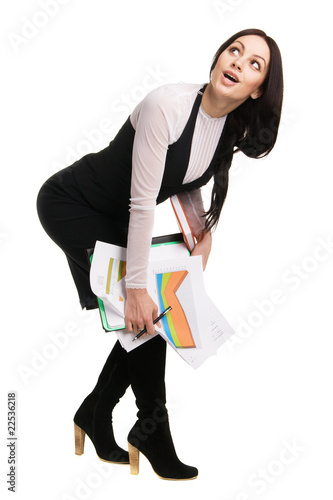 Cheerful businesswoman holding a bunch of documents