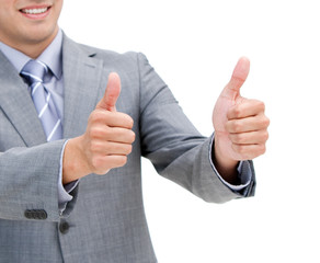 Close-up of a young businessman with thumbs up