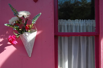 pink house with white flowers