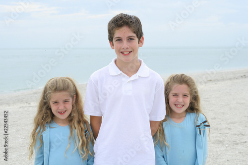 Three beautiful children at the beach