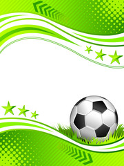 Football background with a soccer ball on the grass