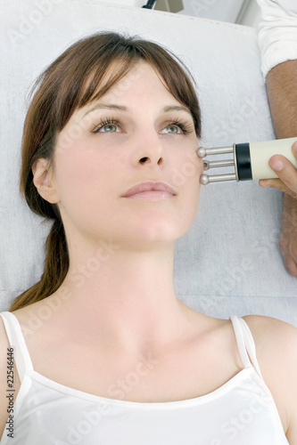 young caucasian woman receiving electrostimulation lifting