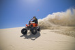 Male ATV rider roosting sand in the Oregon Sand Dunes