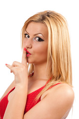 Blond lady with finger on lips