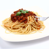 Spaghetti bolognese on a plate and some on a fork