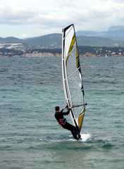 Windsurfer by cold weather