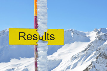 RESULTS sign agains mountain scenery