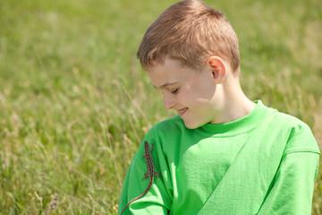Boy with lizard