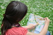 adventurous girl reading a map