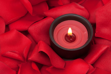 Candle and rose petals
