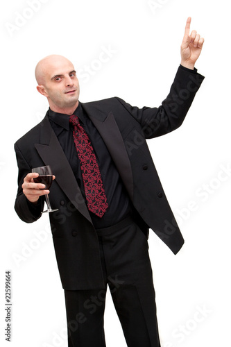 Business man in suit pointing up