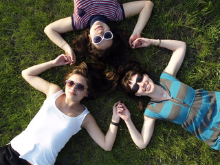 Girls laying on grass