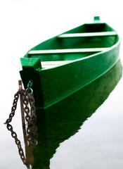 Old fish-boat on lake
