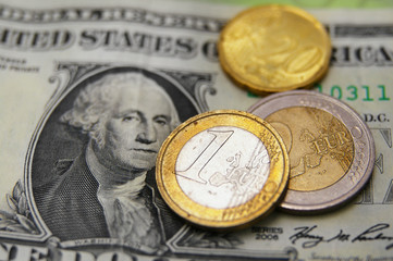 U.S. dollar and Euro coins - exchange rate