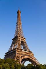Eiffel tower under last rays of sun. Vertical wide angle