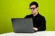 Geek in black shirt working on computer