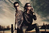 Fototapety Attractive young couple wearing sunglasses