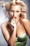 Fototapety Young lady eating a strawberry