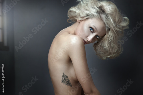 Beautiful nude blonde beauty with tatoo