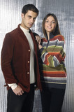 Vogue style photo of young man and woman standing together poster