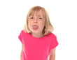 Young little girl sticking out tongue