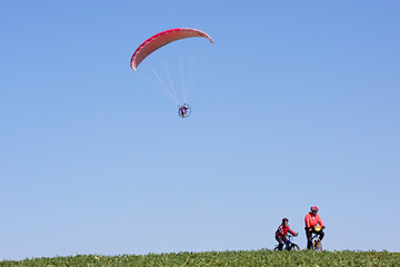 Sports activities powered paraglider and cyclists