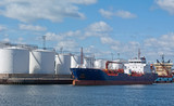 Tanker by quayside storeage tanks