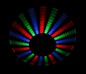 Colorful trace rotating LED in form of disc on a black