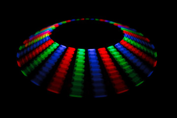 Colorful trace rotating LED in form of a disc on black