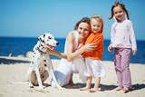 Fototapety Family at beach